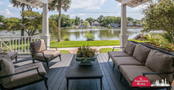 Covered back patio overlooking a peaceful pond